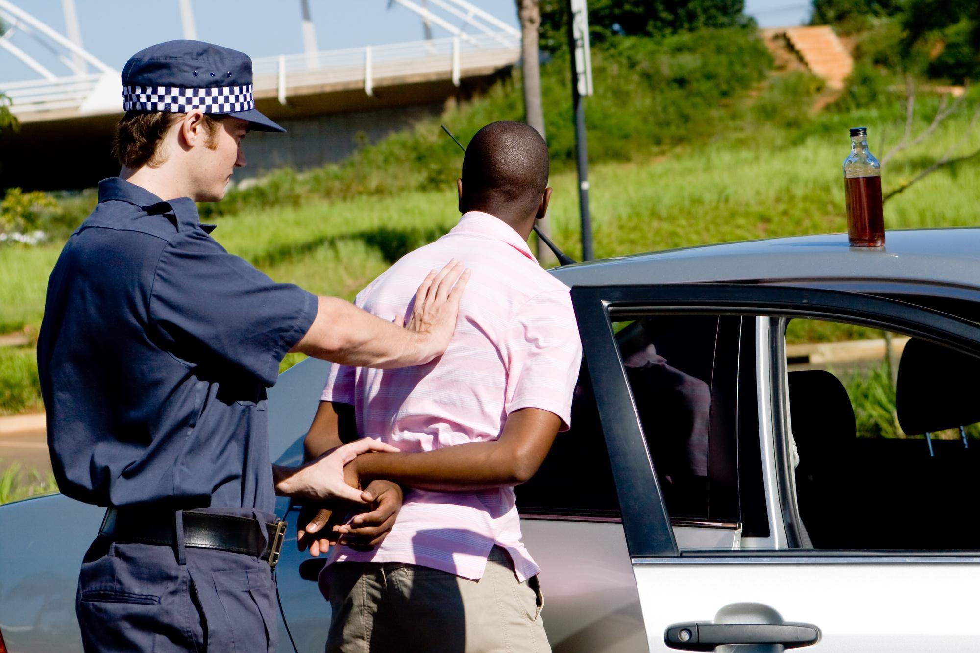 policeman arresting DUI suspect