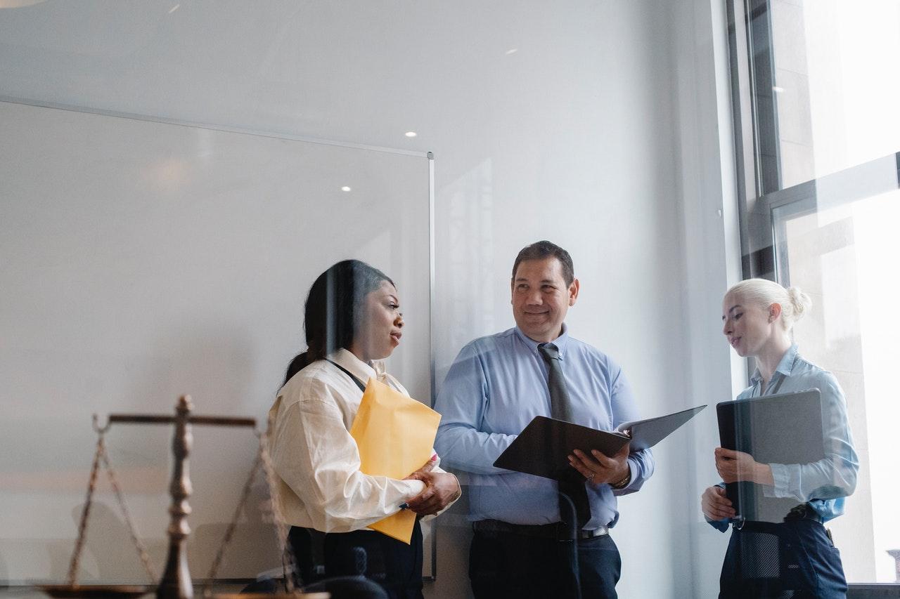 three corporate lawyers talking