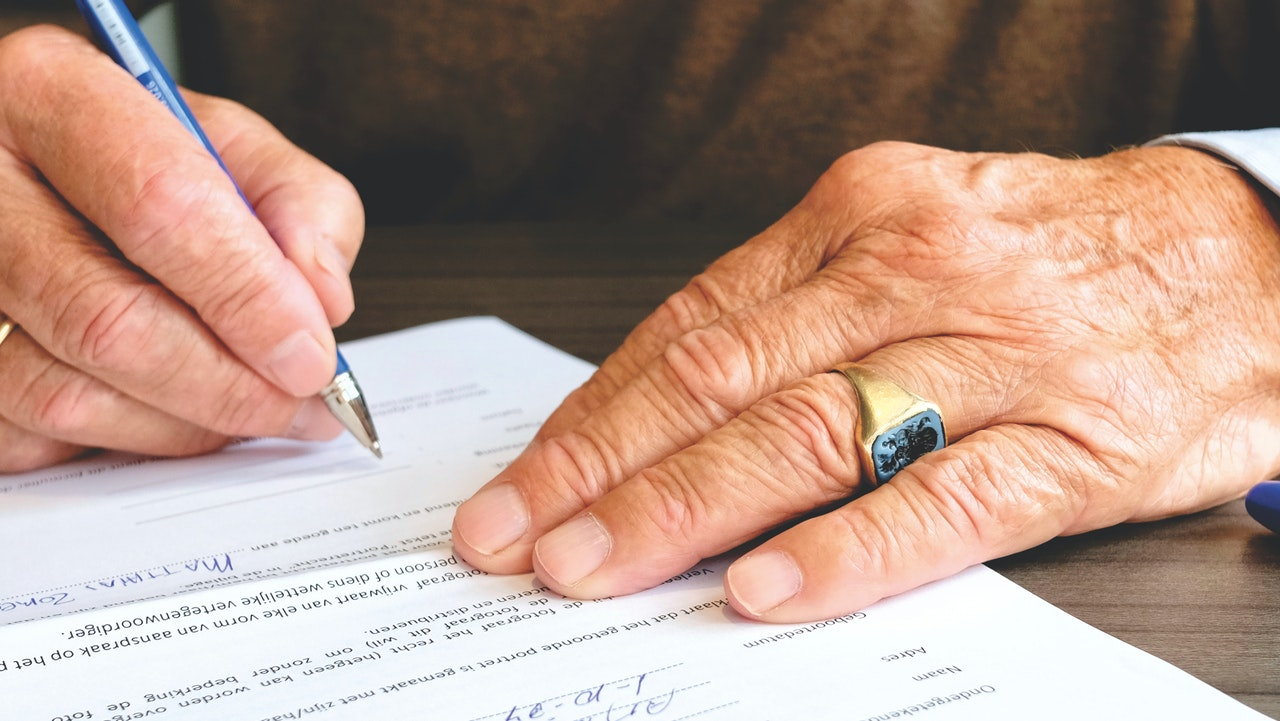 person signing business law document